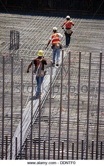 Worker Carrying Rebar Stock Photos & Worker Carrying Rebar Stock ...