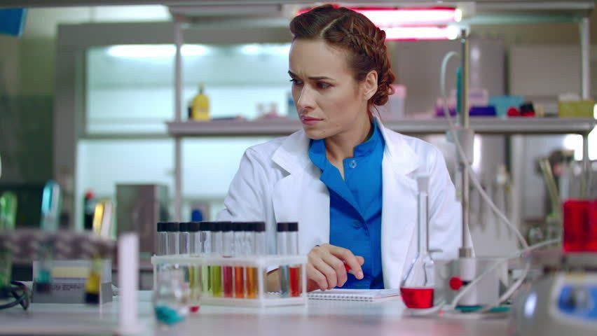Woman Researcher Working In Lab. Female Researcher Writing ...