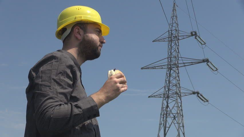 Young Electrician Eating Hamburger Swiping Sweat High Voltage Pole ...