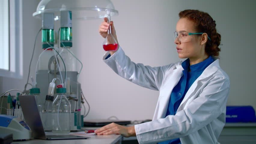 Woman Scientist Working On Chemical Analysis. Chemical Liquid ...