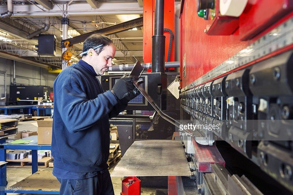 Brake Press Operator At Work In A Metalworking Factory Stock Photo ...
