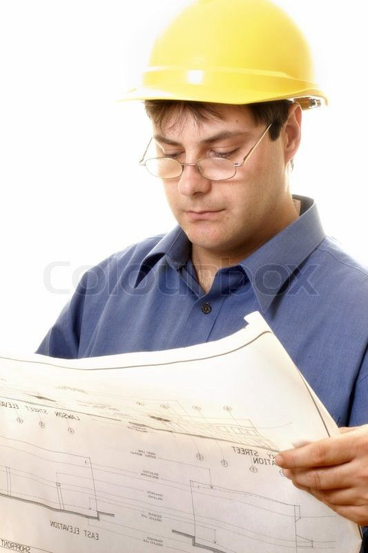 A builder or architect or other trades man reading architectural ...