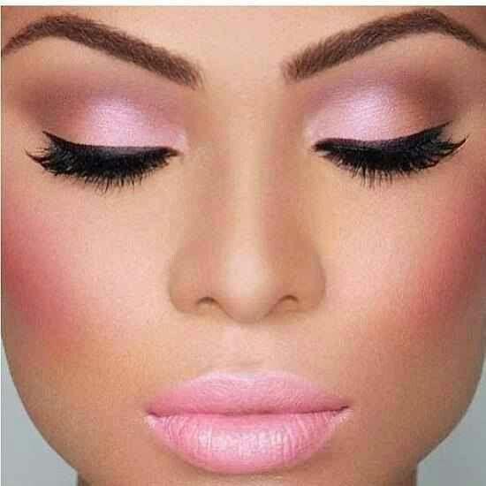 Perfect face. Perfect skin. Perfect makeup. Pink eye shadow. Pink blush. Pink lipstick.  Black fake eyelashes . Nicely done eyeliner.