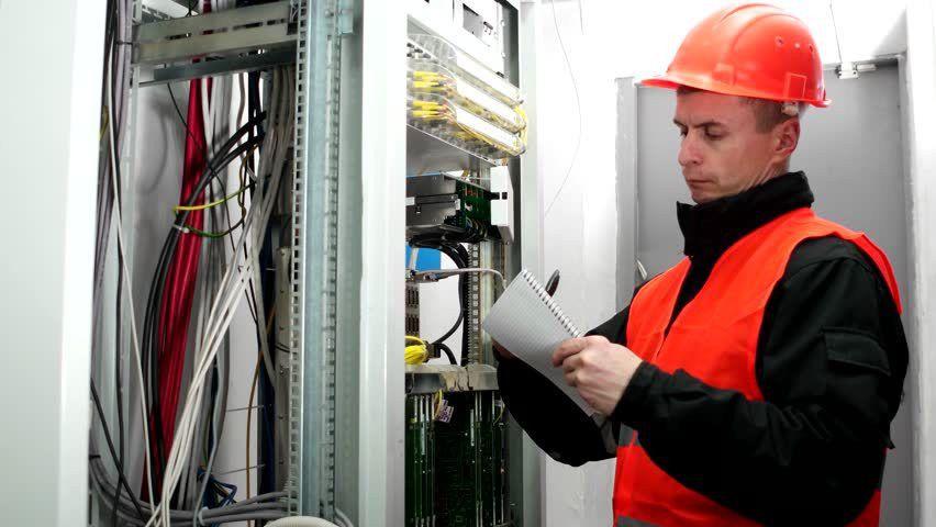 The Engineer Checks The Equipment Communication Tower. Engineer ...