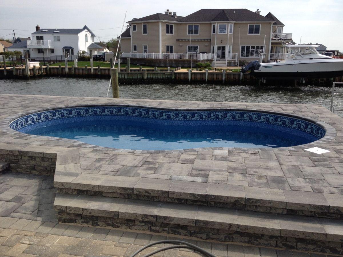Radiant metric freeform pools above semi inground on Semi inground pools