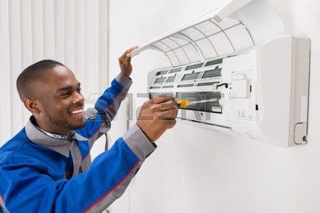 Air Conditioning Mechanic Stock Photos. Royalty Free Air ...