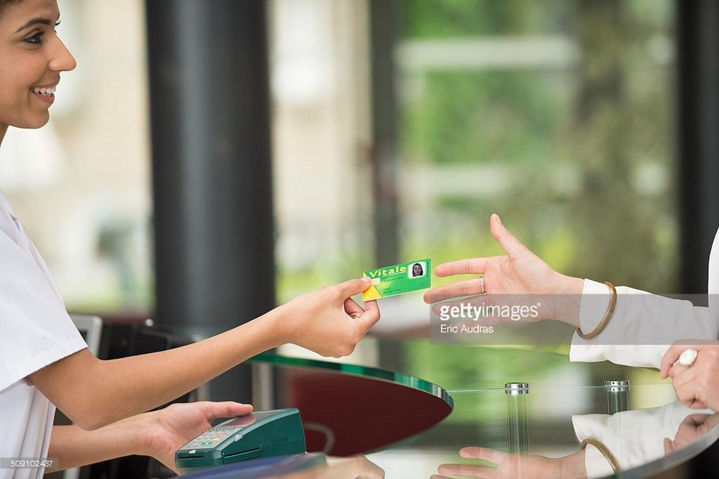 Woman Giving French Social Security Card To Receptionist At ...