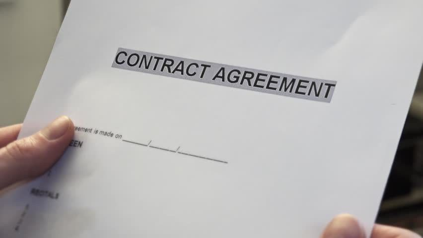 Man With A Blank Contract Agreement Form In Hands. A Contract Is A ...