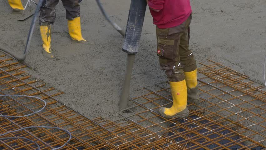 Two Workers Together Tied Reinforcement (tied Rebar) With Pliers ...