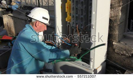 Electrician Working Stock Images, Royalty-Free Images & Vectors ...