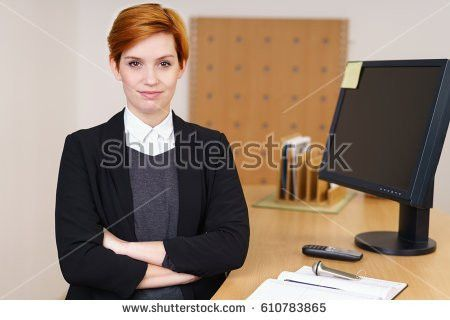 Confident Young Receptionist Behind Front Desk Stock Photo ...