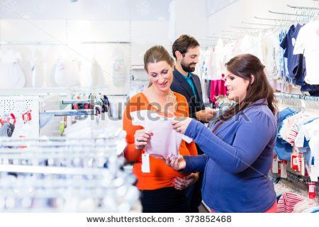 Pregnant Woman Man Buying Baby Clothes Stock Photo 558106783 ...