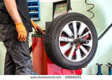 Wheel Balancing Stock Images, Royalty-Free Images & Vectors ...