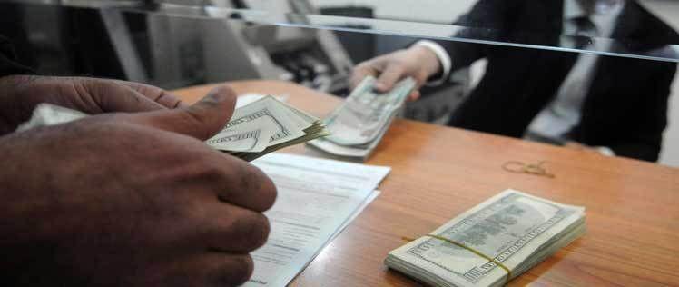 Bank Teller Job Description - Role, Duties, Responsibilities, Skills
