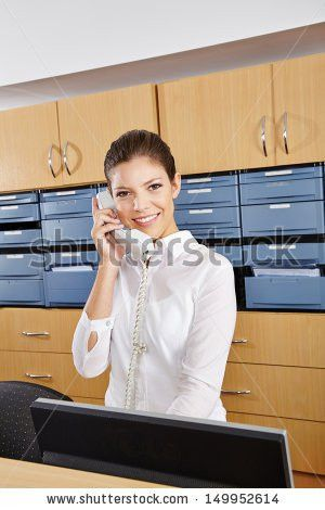 Doctors Office Receptionist Stock Images, Royalty-Free Images ...
