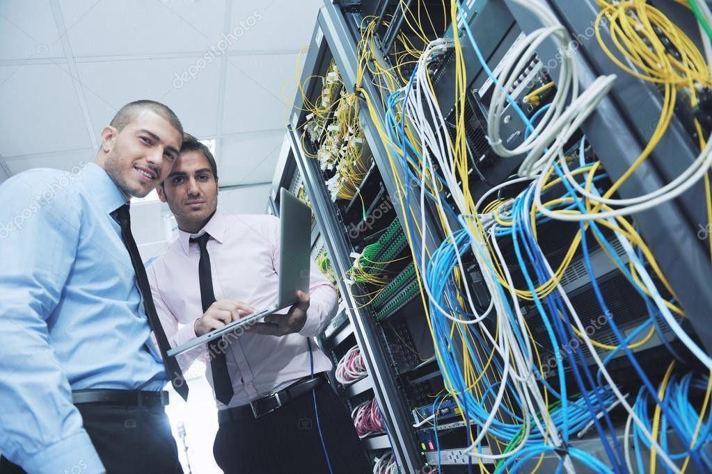 It engineers in network server room — Stock Photo © .shock #7338033