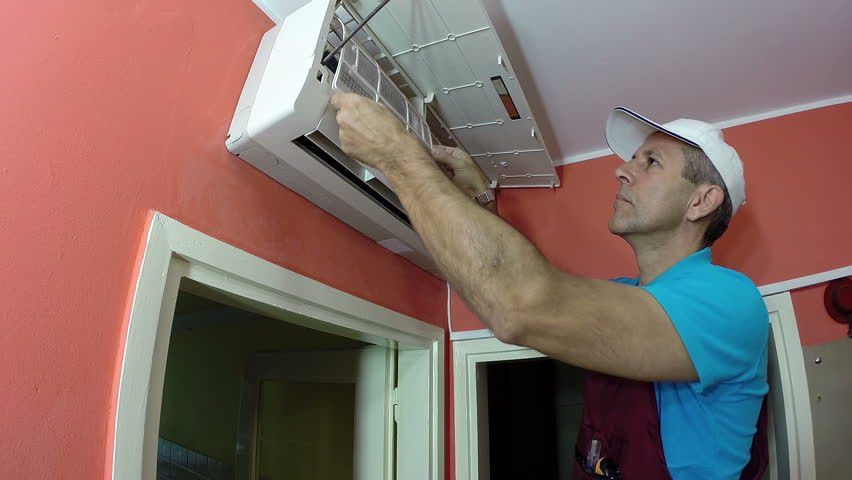 Engineer Doing Air Conditioner Maintenance / Engineer Replacing Or ...