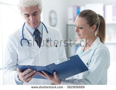 Confident Doctor Office Checking Medical Records Stock Photo ...