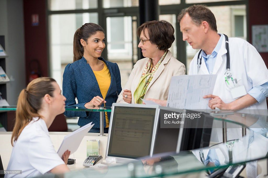 Upset Patient Explaining Problem To Medical Receptionist Stock ...
