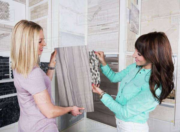 Interior designer and design consultant selecting tiles and grout ...