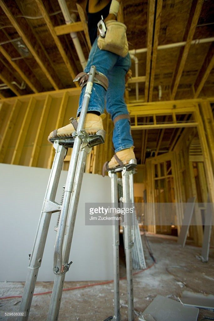 Man Walking On Stilts Stock Photo | Getty Images