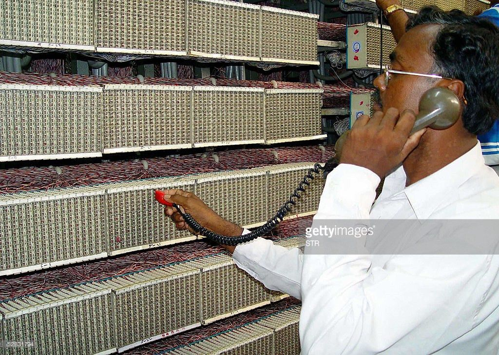 An Indian Telecom technician works on a Pictures | Getty Images