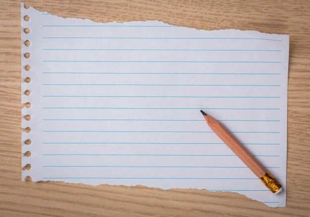 Piece of notebook paper with a pencil Photo | Free Download