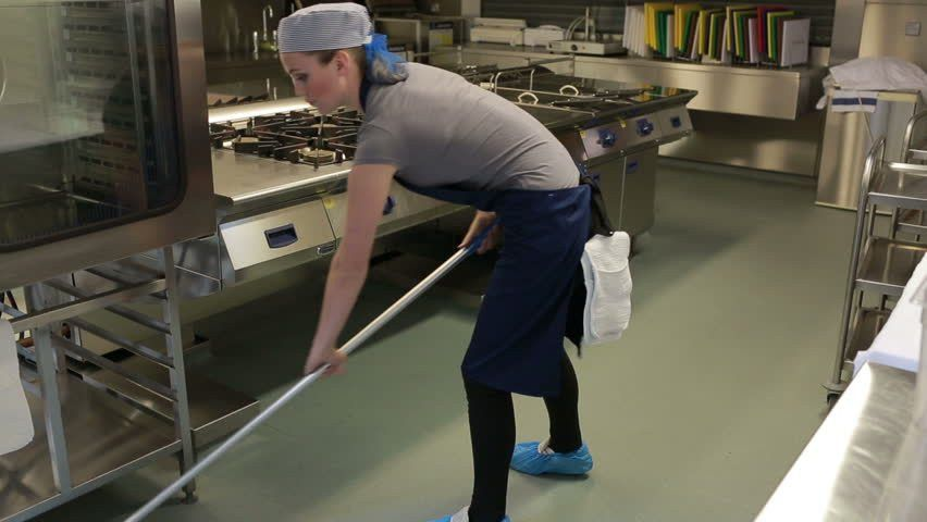 Cleaner Cleaning The Kitchen And Wiping The Floor With A Mop Stock ...