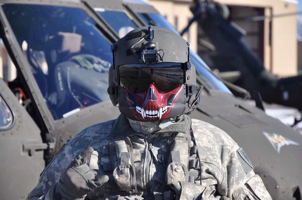 A UH-60 Blackhawk crew chief shows off the new paint job on the ...