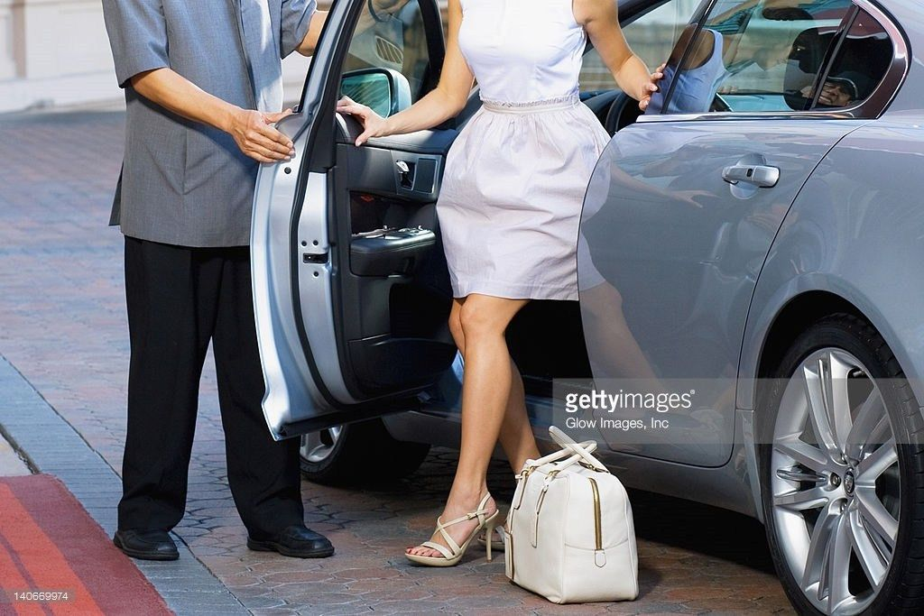Hotel Porter Opening Car Door For A Womanbiltmore Hotelcoral ...