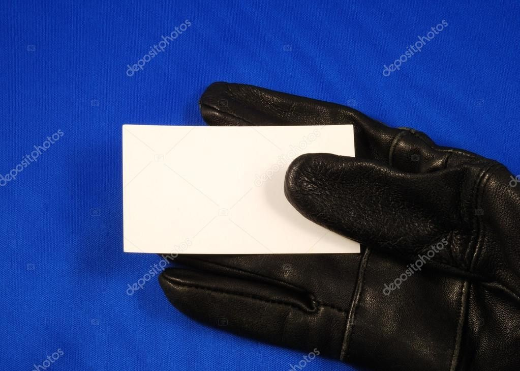 Blank business card on a black glove concepts of invitation or ...