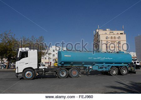 MUSCAT, OMAN Water truck and driver Stock Photo, Royalty Free ...
