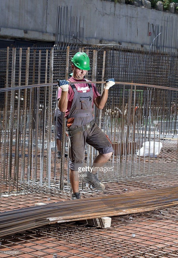 Worker Rebar On Construction Site Positions Secures Steel ...