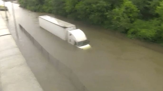 KHOU 11 crew helps rescue truck driver trapped in floodwaters ...