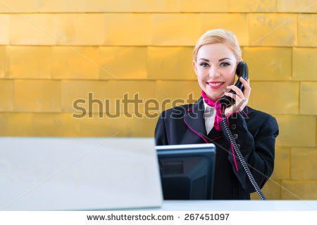 Hotel Receptionist Phone On Front Desk Stock Photo 267451097 ...