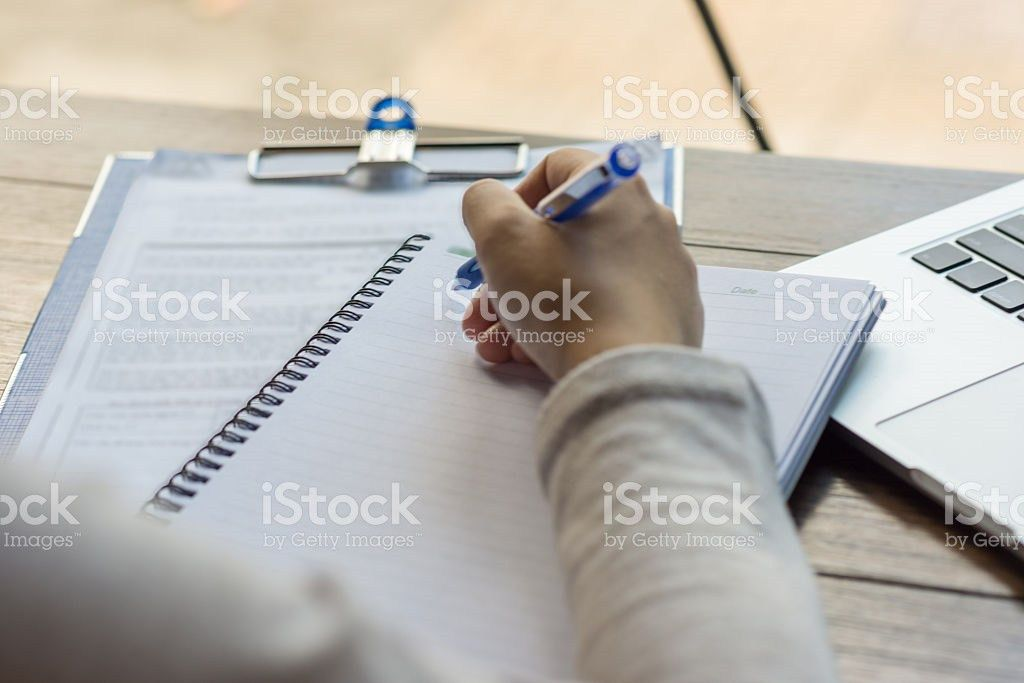 Young Office Employee Writing Weekly Report To Her Boss stock ...