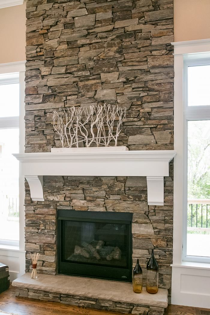 dry stacked stone fireplace but wood beam mantle