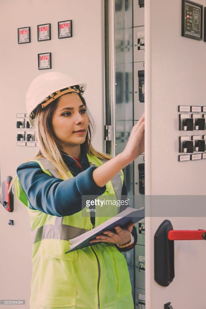 Young Female Maintenance Engineer Working At Energy Control Room ...