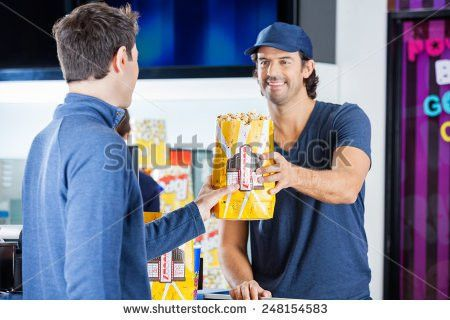 Mid Adult Pregnant Woman Buying Popcorn Stock Photo 259015721 ...