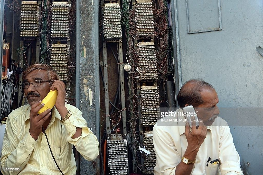 An Indian technician from state-owned fixed line telecom provider ...
