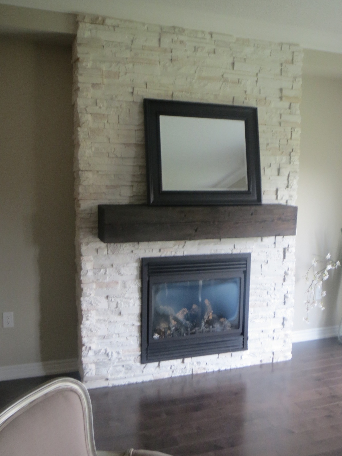 built-in shelving around the white stone fireplace. and ...