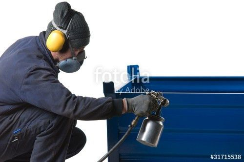 "Industrial painter painting metal product with spray gun."" Stock ..."