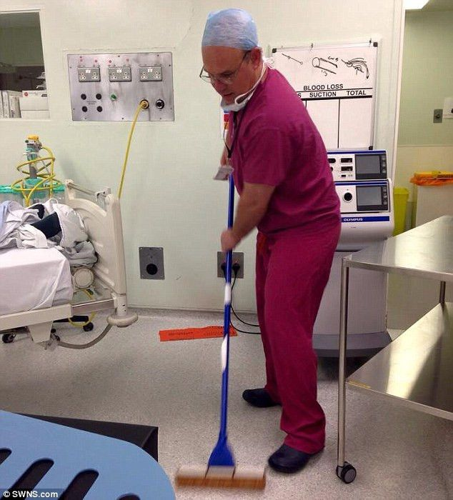 Surgeon Stuart Gould's Facebook picture of himself mopping the ...