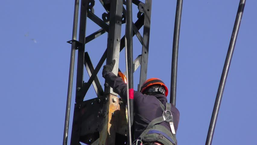 Electricians In A Bucket Fixing High Voltage Electrical Lines ...