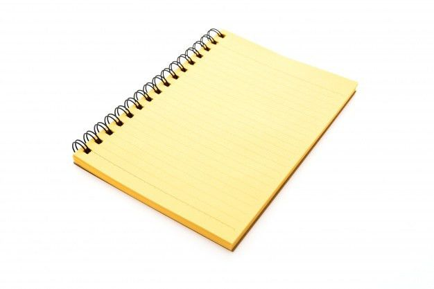 Yellow notebook in a white background Photo | Free Download