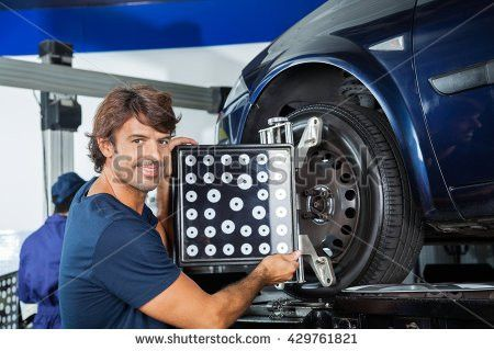 Portrait Happy Mechanic Fixing Car Tire Stock Photo 337120958 ...
