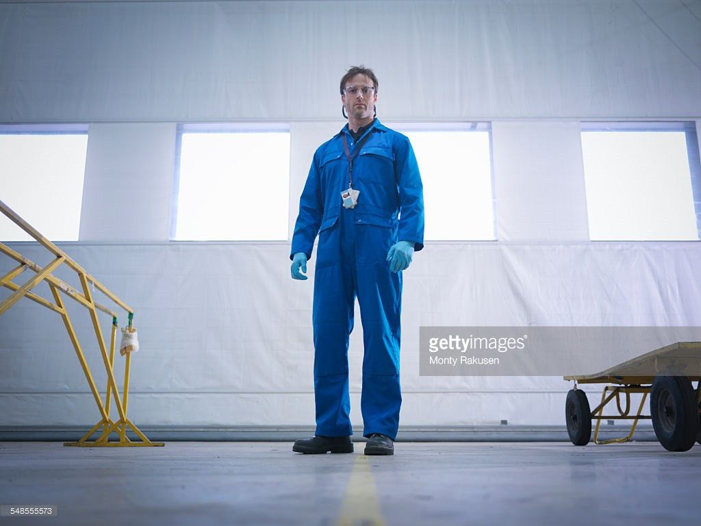 Engineer Holding Spanner In Aircraft Maintenance Factory Close Up ...
