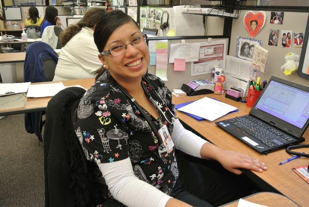 Medical Assistant at her desk... - Clinica Family Health Office ...