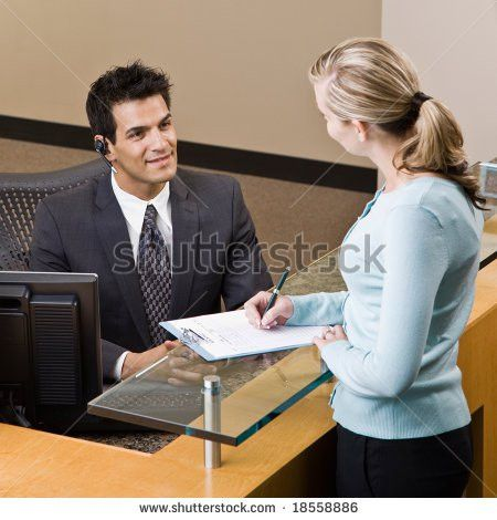 Male Receptionist Stock Images, Royalty-Free Images & Vectors ...