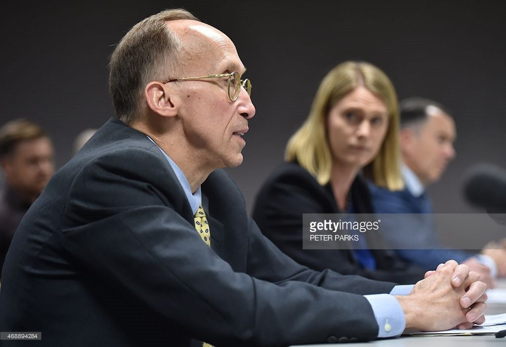 Corporate vice president of Microsoft Bill Sample (L) speaks at an ...